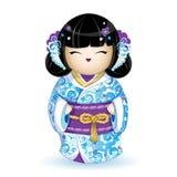 在一件蓝色和服的Kokesh日本全国玩偶有花的风格化海波浪、鸟和样式的 绳索金黄传送带 库存图片