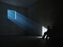 在一间黑暗的监狱牢房里面 免版税库存图片