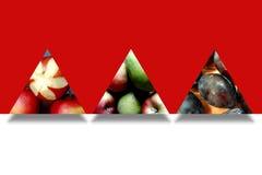 在三个抽象三角里面的秋天果子 免版税库存照片