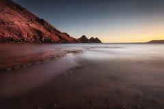 在三峭壁海湾的日落 图库摄影