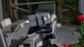 在三脚架的智能手机 免版税图库摄影