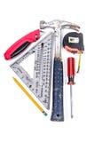 在三角安排的木匠工具 免版税图库摄影