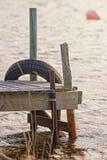 在下午太阳期间的老小跳船 免版税库存照片
