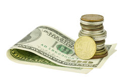 在硬币之下的一百美元与欧洲分 免版税库存图片