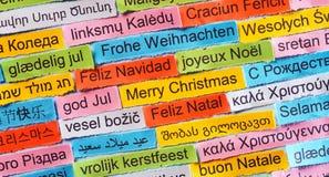 在不同的语言的圣诞快乐 免版税库存图片