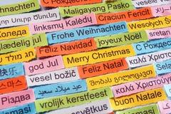 在不同的语言的圣诞快乐 库存图片