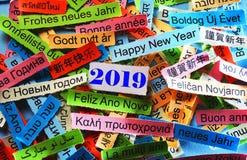 在不同的语言的新年快乐2019年 免版税图库摄影