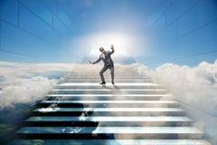 在不确定性概念的商人在事业梯子 免版税图库摄影