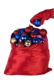 在与圣诞节的一个袋子玩具投入了球 免版税图库摄影