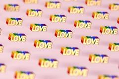 在与彩虹概述样式的金黄爱词射击的特写镜头 6月作为一个月同性恋自豪日和爱概念 在桃红色 库存例证