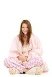 在与玩具羊羔的桃红色毯子包裹的女孩 库存照片