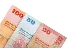 在与裁减路线的白色背景隔绝的100,20,50卢比斯里兰卡的钞票  免版税图库摄影