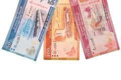 在与裁减路线的白色背景隔绝的100,20,50卢比斯里兰卡的钞票  免版税库存图片