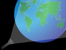 在世界之下的背景手电 免版税库存照片
