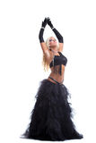 在东方服装的性感的白肤金发的妇女舞蹈 免版税库存照片