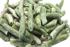 在丝毫的冷冻绿色扁豆 免版税库存照片