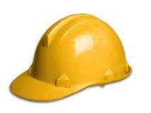 在丝毫背景的盔甲塑料安全帽子 库存照片