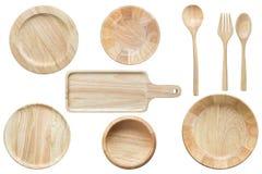 在丝毫隔绝的套明亮的空的木碗和厨具 库存照片