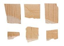 在丝毫隔绝的纸板被剥去的棕色片断的汇集 免版税库存图片