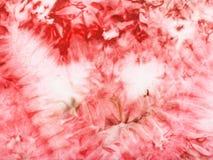 在丝绸蜡染布的抽象桃红色样式 免版税图库摄影
