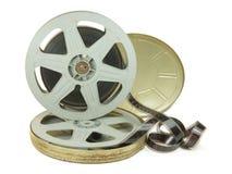 在两个卷轴和它的罐头的35mm影片 免版税图库摄影