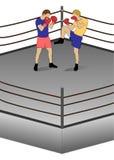 在两位运动员之间的把装箱的战斗圆环的 免版税库存照片