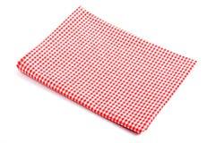 在两折叠的红色格子花呢披肩桌布 图库摄影
