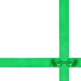 在两条横渡的丝绸丝带的双重绿色弓结 图库摄影