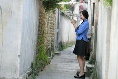 在中华民国的中国女孩穿戴学生衣裳 免版税库存图片