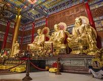 在中国寺庙的三菩萨雕象 库存照片