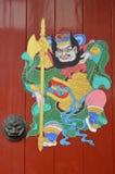 在中国寺庙的门绘画 图库摄影