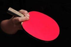 在中国式的举行的正手击球乒乓球的 库存照片