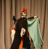 在中国歌剧的男性角色与一张被绘的面孔 免版税图库摄影
