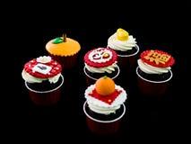 在中国题材的杯形蛋糕 免版税库存图片