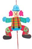 在串的机械小丑玩具 免版税图库摄影