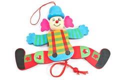 在串的机械小丑玩具 免版税库存图片