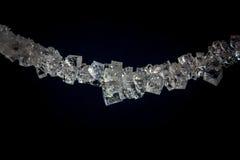 在串的美丽的盐水晶 免版税库存照片