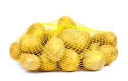在串袋子的土豆,被隔绝, 库存图片