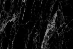 在为背景和设计仿造的自然的黑大理石纹理 免版税库存照片