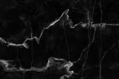在为背景和设计仿造的自然的黑大理石纹理 免版税库存图片