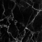 在为背景和设计仿造的自然的黑大理石纹理 免版税图库摄影