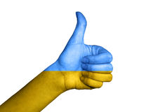 在乌克兰的旗子报道的手 免版税库存照片