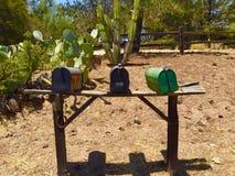 在乡下公路的三个邮箱 免版税图库摄影