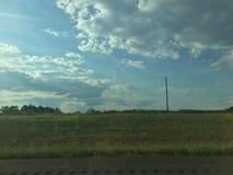 在乡下公路附近的领域 库存照片