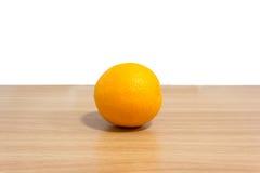 在书桌上的桔子 免版税图库摄影