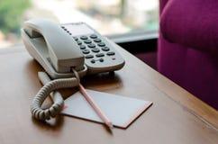 在书桌上的电话 库存照片