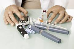 在书桌上的糖尿病设备 库存图片