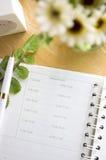 在书桌上的约会记事本 库存图片
