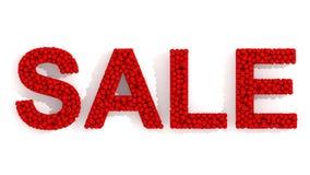 在书桌上的销售标志红色球 免版税库存照片