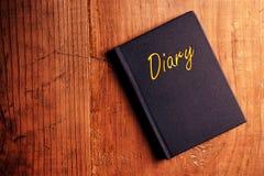 在书桌的日志笔记本 免版税图库摄影